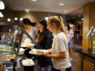 Students getting food in the dining hall