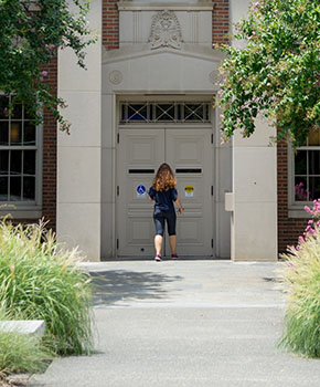 Student entering building