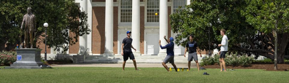 Students Playing Ball on East Campus Lawn