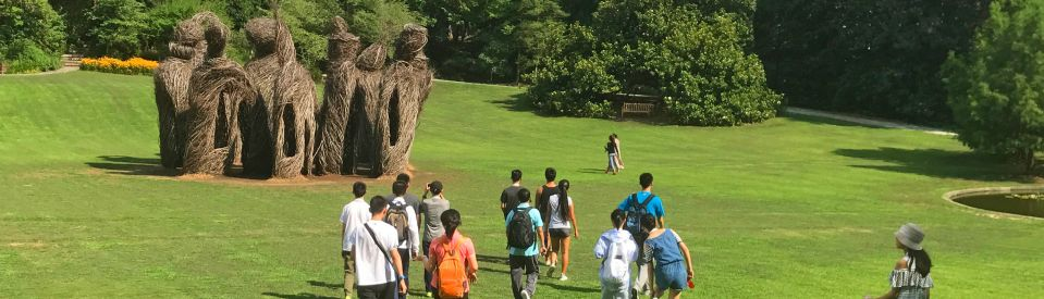 Students walking to Whisper Sculpture